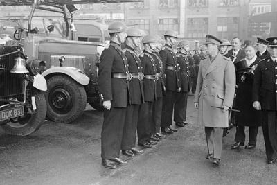 King George VI inspects firemen on his visit to Birmingham during WW2