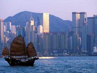 Junk Sailing in Hong Kong Harbor, Hong Kong, China