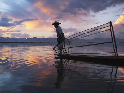 Intha Fisherman Rowing Boat with Fishing Net on Inle Lake, Myanmar, Asia