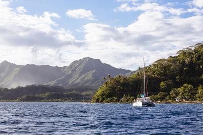 French Polynesia, Society Islands, Raiatea. Catamaran in Choppy Water
