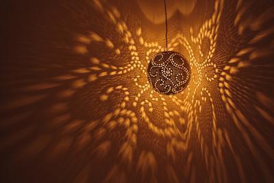 India, Rajasthan, Jaisalmer. Pierced Lamp and Shadows Against Wall