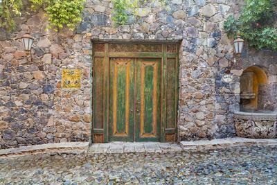 Mexico, San Miguel De Allende. Quaint Doorway in Stone Wall Facade