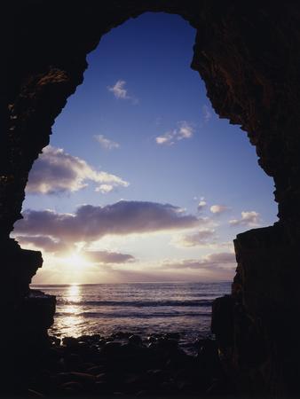 California, San Diego, Sunset Cliffs, Sunset Seen Through a Sea Cave