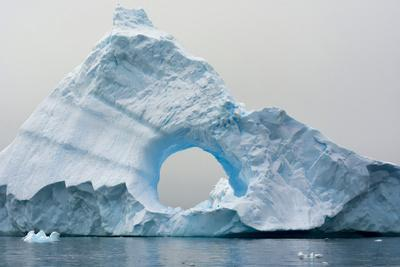 Antarctica. Charlotte Bay. Giant Iceberg with a Hole