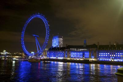 The London Eye Ferris Wheel Along the Thames Embankment at Night