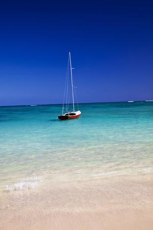 USA, Hawaii, Oahu, Sail Boat at Anchor in Blue Water with Swimmer