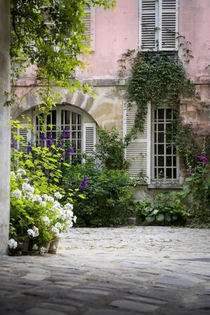 Flowery Building Courtyard in Saint Germaine Des Pres, Paris, France