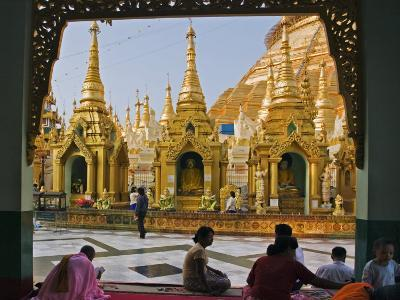 Burma, Yangon, Devout Buddhists Pray at the Shwedagon Golden Temple, Myanmar