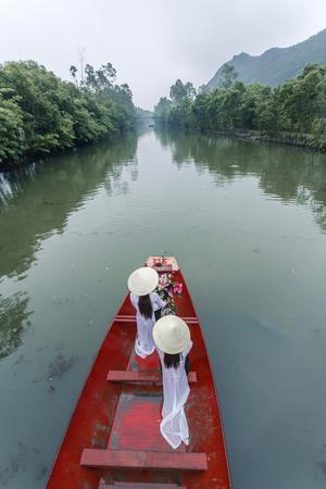 Vietnam, Perfume River. Young Vietnamese Girls on a Boat Going to the Perfume Pagoda (Mr)