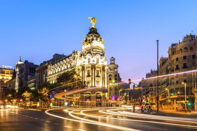 Spain, Madrid. Cityscape at Dusk with Famous Metropolis Building