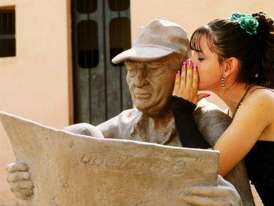 Girl in Quincinera (15th) Birthday Dress Whispering to Statue, Plaza Del Carmen, Camaguey, Cuba