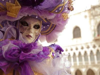 Venice, Veneto, Italy, a Masked Character in Front of the 'Palazzo Dei Dogi' During Carnival