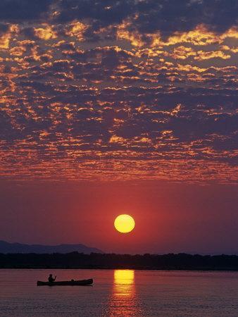 Lower Zambesi National Park, Canoeing on the Zambezi River at Sun Rise under a Mackerel Sky, Zambia