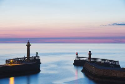 United Kingdom, England, North Yorkshire, Whitby. the Piers at Dusk.