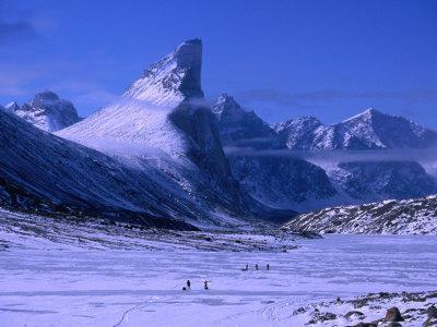 Treeking on Frozen Weasel River with Mt. Thor at Left, Auyuittuq NP, Baffin Island, Nunavut, Canada
