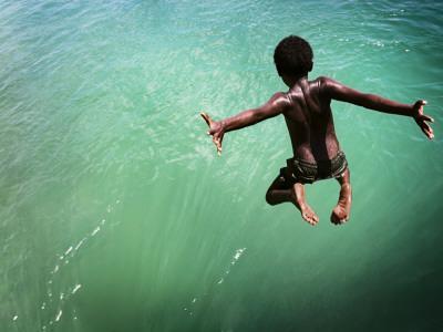 Torres Strait Islander Boy Leaping into the Sea, Seisia, Cape York