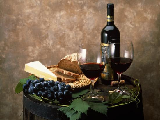 Still Life Of Wine Bottle Wine Glasses Cheese And Purple Grapes On