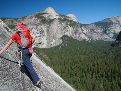 Rock Climber Ascends Slabs at the Base of the Huge Cliff known as the Apron, Yosemite Valley