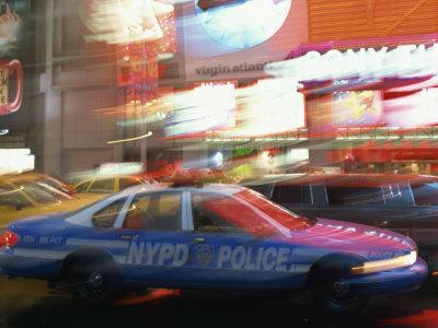 Nypd Police Car Speeding Through Times Square, New York City, New York, USA