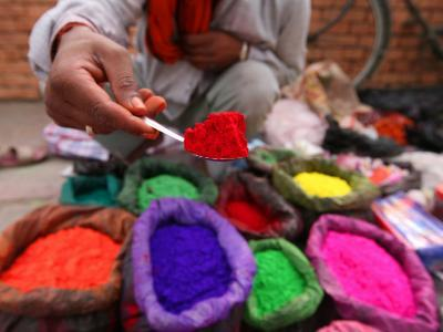 Dye Trader Offers His Brightly Coloured Wares in a Roadside Stall in Kathmandu, Nepal, Asia