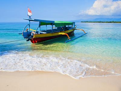 Traditional Indonesian Outrigger Fishing Boat on Island of Gili Meno in Gili Isles, Indonesia