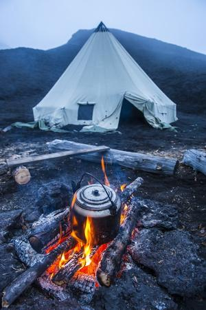 Boiling Water Pot over an Open Fire on a Campsite and Tipi on Tolbachik Volcano