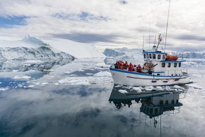 A Commercial Iceberg Tour Amongst Huge Icebergs Calved from the Ilulissat Glacier
