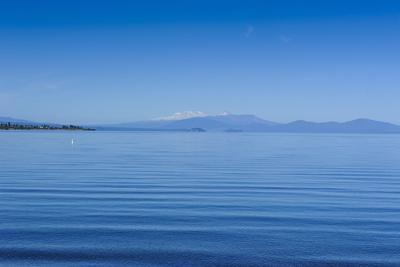 The Blue Waters of Lake Taupo with the Tongariro National Park in the Background