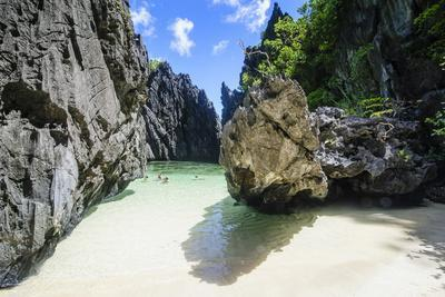 Hidden Bay with Crystal Clear Water in the Bacuit Archipelago, Palawan, Philippines
