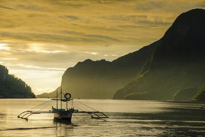 Outrigger at Sunset in the Bay of El Nido, Bacuit Archipelago, Palawan, Philippines