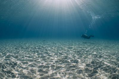 Solitary Scuba Diver in Shallow Sandy Bay, with Sun Beams, Naama Bay