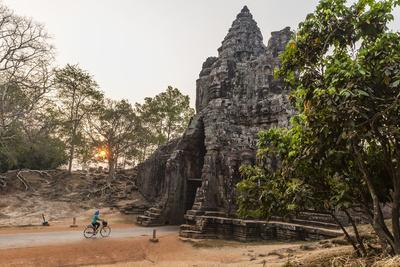 Bicycle Going Through the South Gate in Angkor Thom at Sunrise, Angkor, Siem Reap, Cambodia