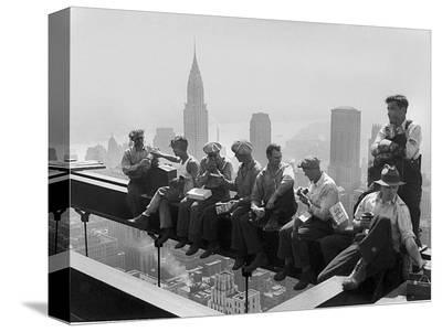 Construction Workers Take a Lunch Break on a Steel Beam Atop the RCA Building at Rockefeller Center