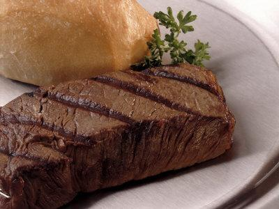 Steak and Roll on Plate