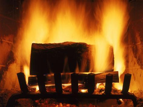 log burning in fireplace photographic print by chris
