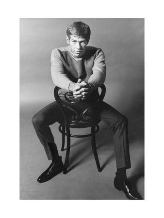 10 Years - People; Actor James Coburn, Seated Backwards on a Chair