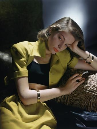 Actress Lauren Bacall Wearing Yellow Bare-Midriff Suit with Black Halter from B. H. Wragge