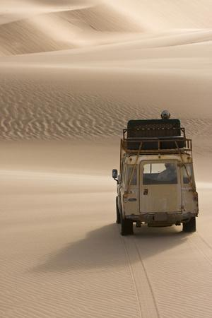 Skeleton Coast, Namibia. Land Rover Venturing Out over the Sand Dunes