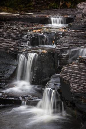 USA, Michigan, Upper Peninsula. Waterfalls in the Presque Isle River