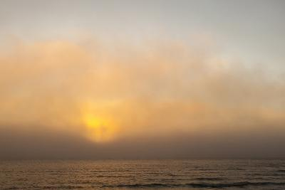 Sunset Light Shining Through Fog Bank of the Florida Coast