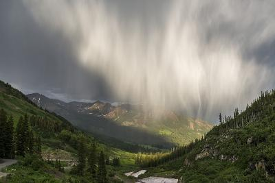 Virga and Storm Moving over Mountains in Colorado