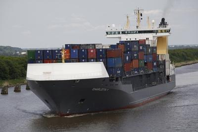 A Containers Ship Travels the Kiel Canal, Germany