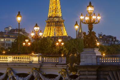 Twilight over Pont Alexandre III with Eiffel Tower, Paris, France