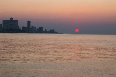 Cuba, Havana. Sunset Along the Malecon, Havana Bay