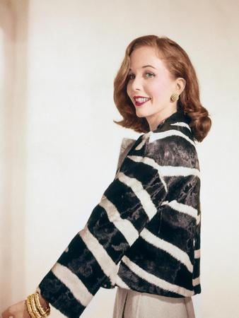 Side View of Brooke Hayward Wearing Rhinestone Jewelry and a Zebra Jacket Made by Ben Kahn