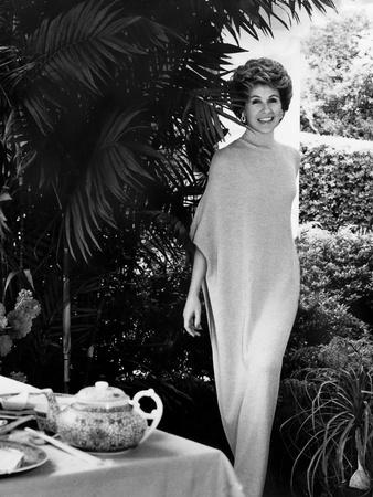 Socialite Betsy Bloomingdale (Mrs. Alfred Bloomingdale) Wearing a Long Flowing Turtleneck Dress