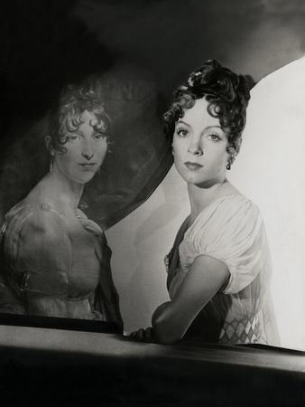 Mrs. W. Palmer Dixon Beside the Gerard Portrait of La Reine Hortense