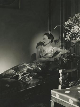 Duchess of Windsor Wearing a Lame Gown Reclining on a Chaise
