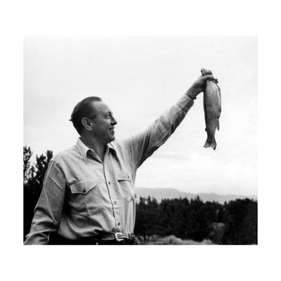 William Paley S. Holding a Fish