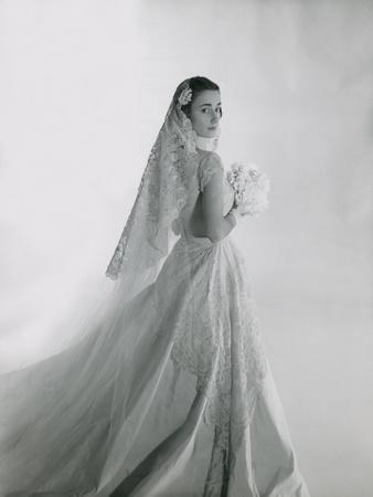 Mrs. Eugene F. Williams Jr. Wearing Her Wedding Gown with Long Train